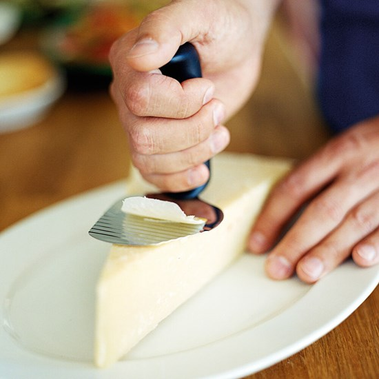 Etac-Relieve-cheese-slicer-in-use_548828.jpg